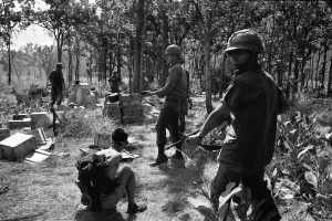 American soldiers guarding North Vietnamese prisoners near the Ia Drang Valley in