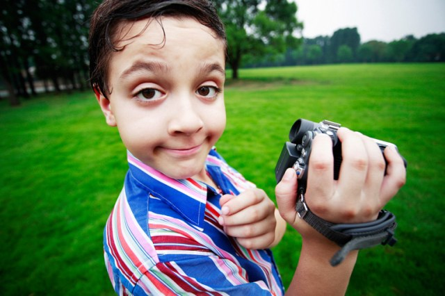 Make money on YouTube - Boy holding camcorder