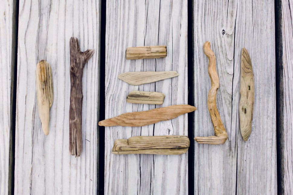 A collection of driftwood sitting on a dock.