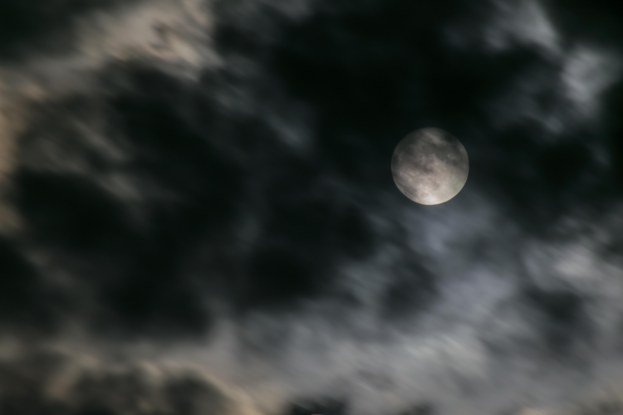 Moon Through The Clouds