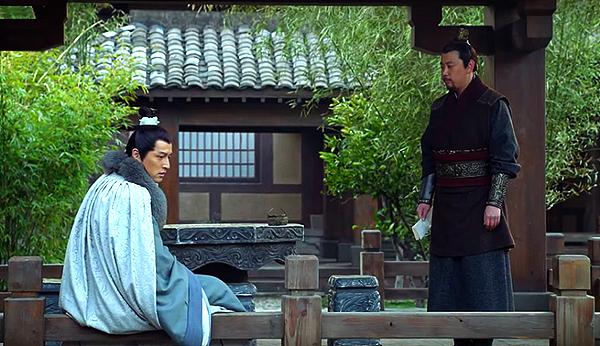 Mei Changsu sitting by a garden pond