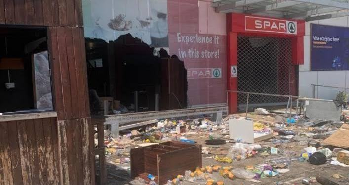 Angry mob turn on private businesses as Nigeria's socio-economic crises is laid bare