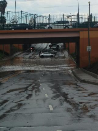 Rain stops the traffic with water under the overpass on University Avenue. (Courtesy of Tanner Summers)