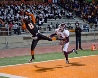 TOUCHDOWN: Isaac Whitney completes the pass and scores a touchdown for RCC at the state semifinals held at RCC on Nov. 29, 2014. (Michael Walter   Asst. Photo Editor)