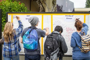 Luis Solis | Photo Editor Words on the wall: Students had the opportunity to write words of gratitude to veterans on a wall Nov. 11.
