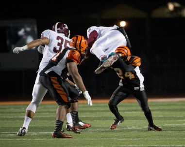 UP IN THE AIR: RCC's defensive back Ray Ford gives his all to stop Mt. SAC from advancing on the field at the state semifinals held at RCC on Nov. 29, 2014. (Michael Walter   Asst. Photo Editor)