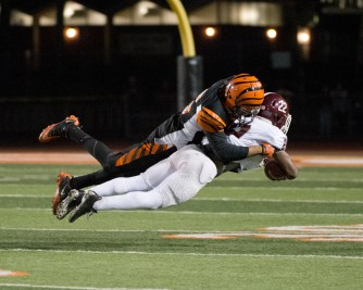 AIR BOUND: RCC defensive back Terin Solomon of RCC takes Mt. Sac's wide receiver Aaren Vaughns off his feet with an incredible tackle at the state semifinals held at RCC on Nov. 29, 2014. (Michael Walter   Asst. Photo Editor)