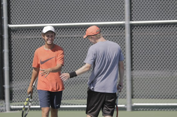 Riverside City College sophomores Patrick Stetco and Conner Stephenson come together during their doubles match in the 2015 OEC Tournament on April 10