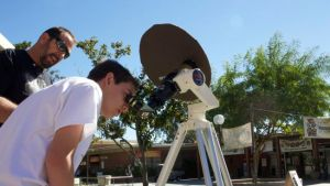 RCC Astronomy professor Scott Blair helps students and centennial event guests use a solar telescope to safely look into the sun.
