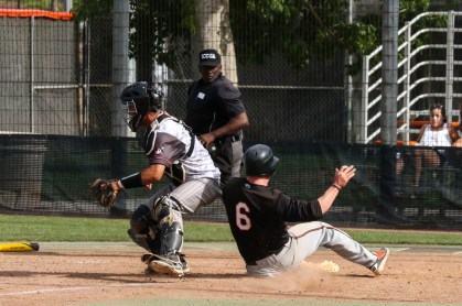 Casey Sheehan scores the go-ahead run in the bottom of the seventh inning off a two out single from Zach Grande against visiting Orange Coast College on April 19.