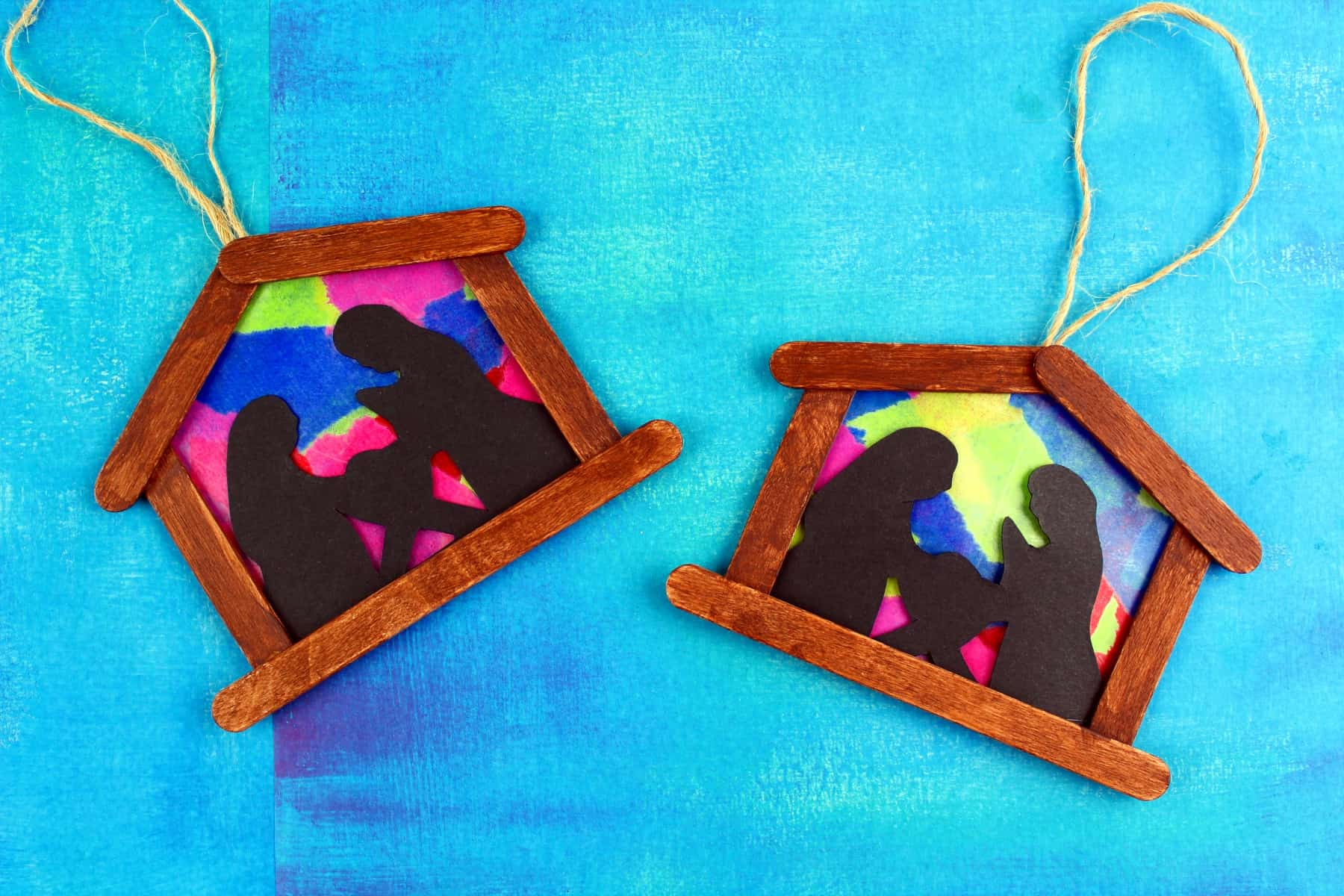DIY ornaments make excellent keepsake crafts or gifts! These stained glass nativity ornaments are awesome for big kids to complete independently, or great for toddlers as their make the mosaic themselves on a sticky table.