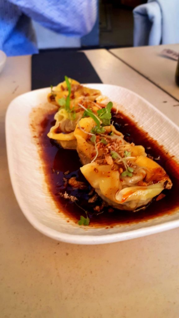 a rectangular plate of four gyoza