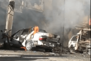 A view of burning cars after powerful explosions rocked Pakistan's northwestern city of Peshawar on September 29, killing 41 people. It was the third terrorist attack in the city in one week killing more than 140 people. (Photo off video stream)