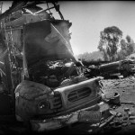 Trucks destroyed during military operations against the Taliban stand in a fuel station in Dagar, Buner district, North-West Frontier province, Pakistan on May 15, 2009. (Photo by Balazs Gardi, Creative Commons License)