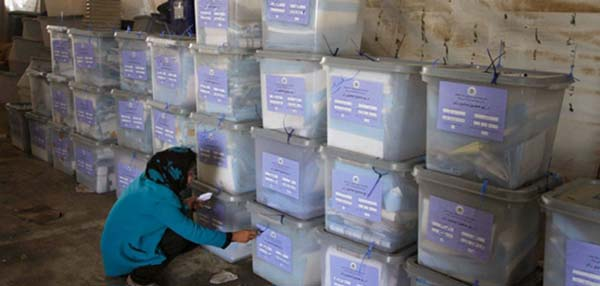 An election worker counting ballot boxes. (Photo via Daily Outlook Afghanistan)