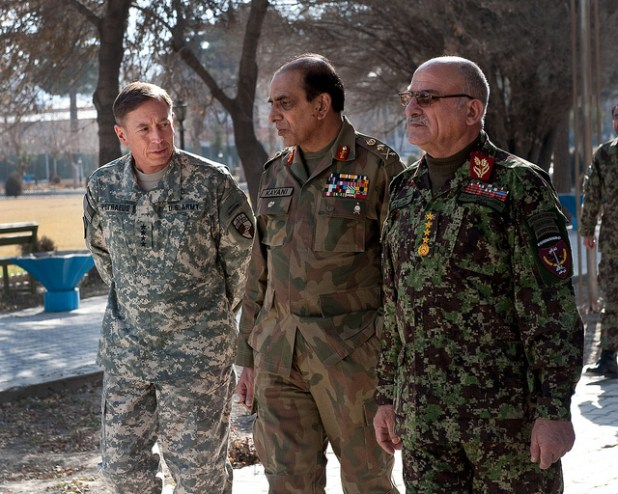 File Photo: From left to right, Gen. David H. Petraeus, commander of the International Security Assistance Force, met with Pakistan Chief of Army Staff Gen. Ashfaq Kayani and Afghan Chief of General Staff Gen. Sher Mahammed Karimi, during a Tripartite Commission, Dec. 23, 2010. (Photo by isafmedia)