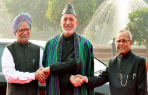 President Hamid Karzai with Indian President Pranab Mukherjee and Prime Minister Manmohan Singh in November 12, 2012.