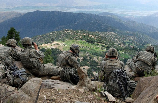 Scouts from 2nd Battalion, 503rd Infantry Regiment search a village below the Chowkay Valley in Kunar Province. One of the diverging point in the talks is Afghanistan's demand from the US to protect it against any foreign aggressions. (Photo by US Army)