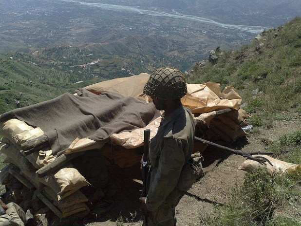 A Pakistani soldier gaurds his post overlooking a valley in the restive FATA region. (Photo by Al Jazeera English, Creative Commons License)