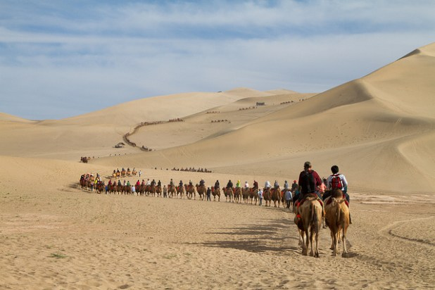 Silk route passing through De Mingsha Sand Dunes in Dunhuang, China. (Photo by Martha de Jong-Lantink)