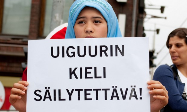 A demonstrator holds a placard in Helsinki  during a 2011 protest demanding  respect of Uighur human rights in China. (Photo by Amnesty Finland, Creative Commons License)