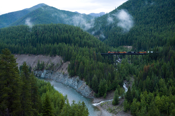 A train crosses a bridge in the Walton area of Glacier National Park in Washington state. (Photo via OnEarth)
