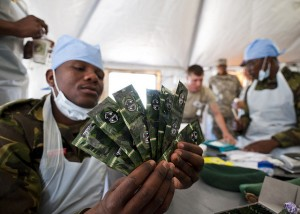 A Botswana Defense Force health specialist displays free contraceptives which are provided to local Monwane villagers and others who traveled long distances to receive medical treatment. (Photo by US Army Africa, Creative Commons License)