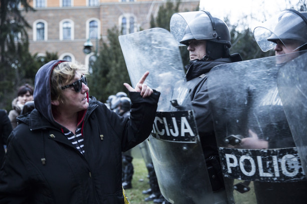 Protesters argue with police in Sarajevo on February 8, 2014, outside the city's municipal building. It sustained heavy damage after protesters attacked and set fire to it. (Photo by Jodi Hilton via WNV)