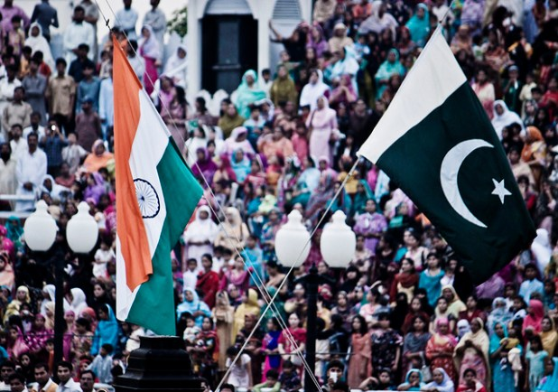 The flags of India and Pakistan are lowered simultaneously at the Wagah Border. The crowd on the Pakistani side of the border are pictured. (Photo by  Jack Zalium, Creative Commons License)