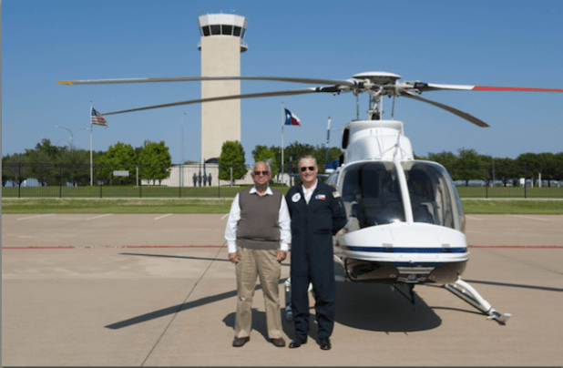 Ikram Sehgal with Ross Perot Jr. at Dallas Fort Worth Airport.