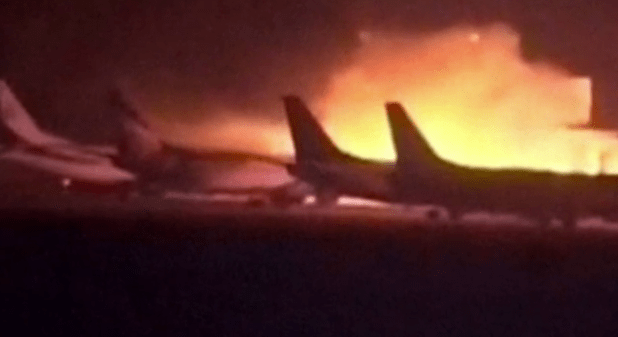 Huge flames behind parked planes during an attack on Karachi airport on June 8, 2014. Pakistan has long suspected India's involvement in many daring attacks in recent years. Indian Defense Minister's daring statement has reinforced these suspicions. (Photo via video stream)