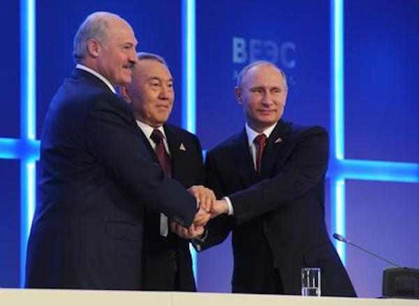 Russian President Vladimir Putin (R), Kazakhstan's President Nursultan Nazarbayev (C) and Belarussian President Alexander Lukashenko (L) shake hands during a joint statement for press following the signing ceremony  in Astana, Kazakhstan, 29 May 2014.  Putin and his counterparts from Kazakhstan and Belarus signed a deal forming an Eurasian Union between the three states. (Photo by EPA/Mikhail Klimentyev/RIA Novosti via East Asia Forum)
