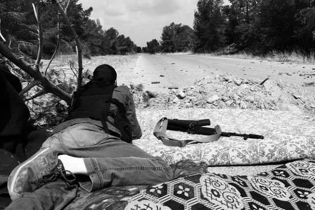 File photo -- A Libyan rebel takes position near Gaddafi-controlled area in May 2011. (Photo by mojomogwai, Creative Commons License)