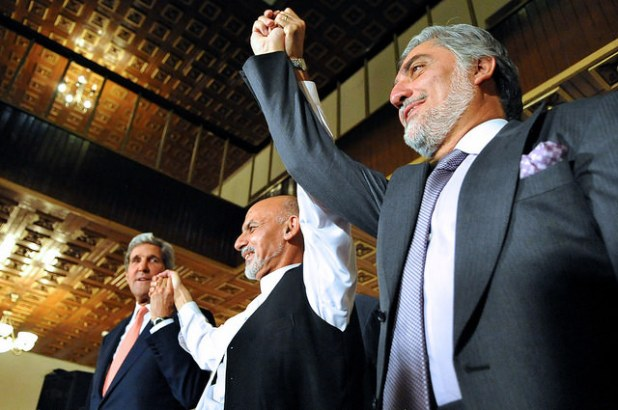Secretary of State John Kerry raises hands with  Ashraf Ghani, left, and Abdullah Abdullah, right, at the United Nations Mission Headquarters in Kabul, Afghanistan on July 12, 2014, after they told reporters about the details of an agreement on a technical and political plan the Secretary helped broker to resolve the disputed outcome of the election between them. (State Department photo, Creative Commons License)