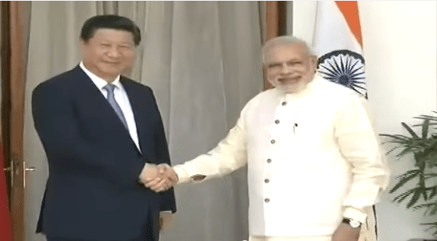 Indian Prime Minister Narendra Modi shaking hands with the Chinese President Xi Jinping at Hyderabad House in New Delhi on September 18, 2014. (Photo from videostream)