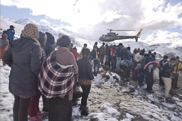 DISASTROUS AUTUMN: The storm came in October, when locals and trekkers least expected it. Nepal Army helicopters arrived on the morning after to ferry out the survivors of the blizzards and avalanche in Manang. (Photo via Nepali Times)