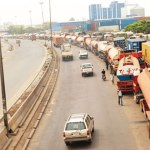 Trucks lined along a highway in Abuja.