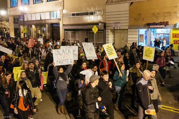 Protest in Oakland, California, following the no indictment decision for the killing of Michael Brown by Darren Wilson in Ferguson, St. Louis, Missouri. (Photo by Amir Aziz, Creative Commons License)