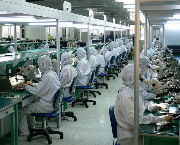 Thousands of workers in this factory assembling and testing fiber optic systems. In many places of the Chinese economy, human labor replaces automation. (Photo by Steve Jurvetson, Creative Commons License)