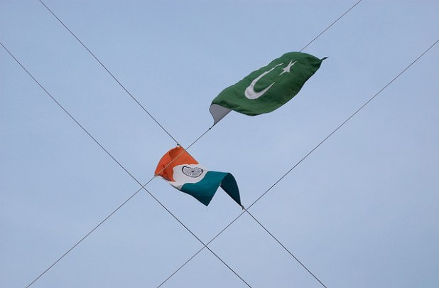 Pakistani and Indian flags at the two countries border . (Photo by Global Panorama, CC License)