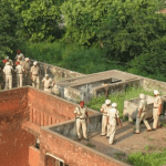 Indian police on top of the police station building after completing a 12-hour long  operation against terrorists in Gurdaspur. (Photo by Anumeha Yadev, via  Scroll.in)