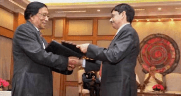 Nagaland leader and Indian government officials exchange landmark peace agreement documents in New Delhi on August 4. (Photo from video stream)