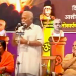 Prime Minister Narendra Modi listens to the speech of RSS Chief Mohan Rao Bhagwat at a book launching ceremony in 2012. (Photo via video stream)