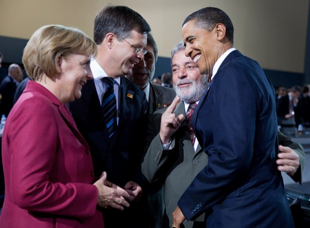 President Barak Obama (R), Brazilian President Luiz Inacio Lula da Silva (2nd R), Netherland Prime Minister Jan Peter Balkenende (2nd L) and German Chancellor Angela Merkel (L) share a laugh prior to the G20 leaders holding the opening working Plenary session at the Convention Center September 25, 2009 in Pittsburgh, Pennsylvania. (International Monetary Fund Photograph by Stephen Jaffe, Creative Commons License)