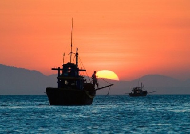 Sunset on the South China Sea. (Photo by Times Asi, Creative Commons License)