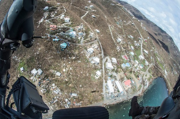 Airmen from the New York Air National Guard's 106th Rescue Wing fly over St. Thomas and St. John in an HH-60 Pave Hawk helicopter on 10 September, 2017. They're searching for people in need of critical assistance in the wake of Hurricane Irma. (Photo by New York National Guard, CC license)