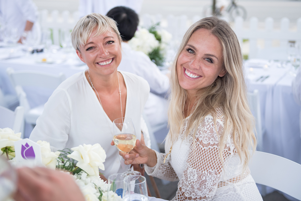 Award winning local Toronto blogger, Casie Stewart and guest enjoying the dinner and drinks at the 2018 Diner en Blanc in Toronto   View the VIBE