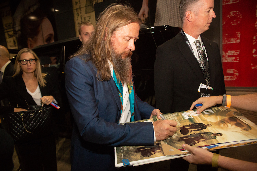 TIFF 2018 afterparty - David Mackenzie seen signing autographs outside Patria where the premiere party for Outlaw King was hosted | View the VIBE