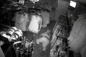 burglar crawling away from camera