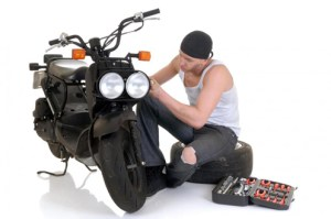 man-working-on-motorcycle